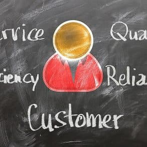 Attributes on a chalk board: Service, Efficiency, Quality, Reliability and Customer at the centre