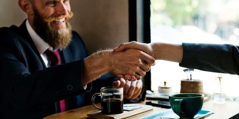 Satisfied customer shaking hands