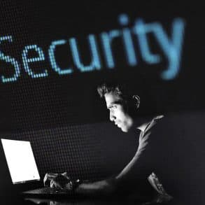 Image of a programmer with Security written over his head.
